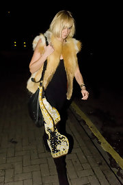 Kimberly Stewart jazzed up her look with this yellow fur vest.