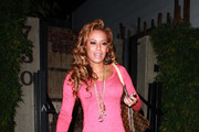 Spicy Mel B jumps into her waiting car after dining at Koi restaurant in LA. Mel made a return to
