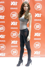 Irina Shayk posed at the XTi launch in black mesh cutout ankle booties.