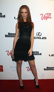Sports Illustrated model Cintia Dicker arrived at an event in Vegas wearing an all-black ensemble including a pair of sky-high pumps.