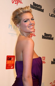 Kate Upton attended the 'Sports Illustrated' Overtime event wearing her hair in a causal updo with voluminous bangs.