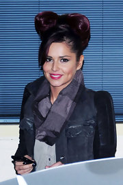 Cheryl Cole showed off her high bun while leaving the X-Factor studios. The pop star twisted her locks into a big bow, while layered bangs framed her face.