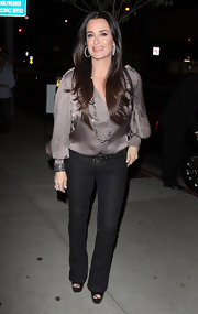 Kyle Richards celebrated her birthday in a pair of tight bootcut jeans and a relaxed silky blouse.
