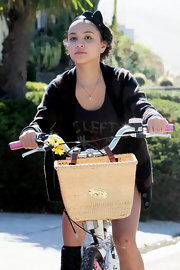 Stella Hudgens topped off her bicycle riding look with a sweet black bowed headband.