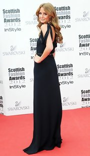 'Made in Chelsea's' Millie Mackintosh showed off the back detail of her floor-length gown at the Scottish Fashion Awards.