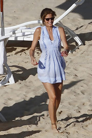 Stephanie was beach-chic in a light blue embroidered tunic.
