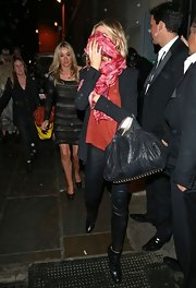 Abbey Clancy was edgy-chic in her red and black ensemble, consisting of a blazer, scarf, leather skinnies, and ankle boots.