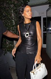 Rihanna adorned her leather top with an oversize cameo necklace with a velvet ribbon.