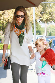 Jessica added extra color to her outfit with this orange and green patterned scarf.