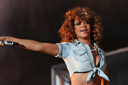 Rihanna wore her hair in a halo of cinnamon-colored curls during a performance at V Festival.