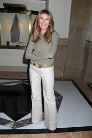 Nina Garcia channeled the '70s with a pair of beige flare pants at the Dennis Basso show.