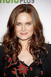Emily Deschanel wore her shiny hair in long waves and curls while attending PaleyFest 2012.