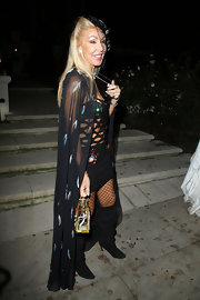 Linda Thompson completed her sexy Halloween look with slouchy black knee-high boots.