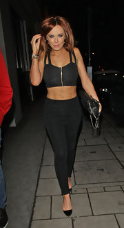 Maria Fowler was a head-turner in a black crop-top and leggings while enjoying a dinner date.