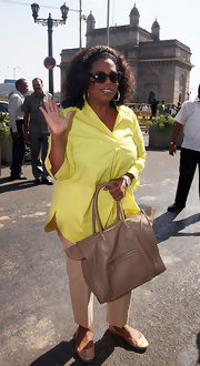 Oprah Winfrey accessorized her low-key look with a luxe camel tote.