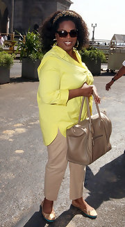 Oprah opted for tan flats while out and about Mumbai.