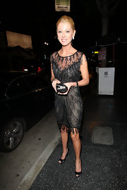 Tara Reid dined at Katsuya in black satin peep toes.