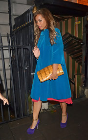 Leona Lewis popped on some print with this animal print oversized clutch.