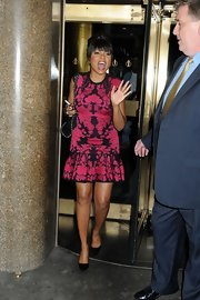 Taraji looked colorful in this bright cocktail dress out in NYC.