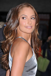For Minka Kelly's appearance on the 'Late Show With David Letterman', she wore her long locks in soft waves.  To try her look at home, curl two-inch sections with a large-barreled curling iron, making sure to curl each piece in the same direction. Next, lightly comb through hair to soften curls and finish with a product like ALTERNA Caviar Anti-Aging Rapid Repair Spray for added shine.