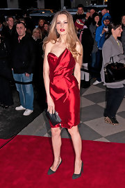Petra topped off her red satin dress with suede pumps.