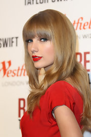 Taylor wore her thick banged 'do with a slight wave at the Christmas Lights soiree in London.
