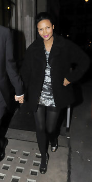 Thandie is rich with texture in a black boucle coat out in London.