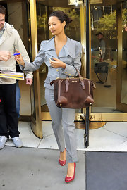 Thandie Newton showed off her chic side in a grey tailored suit and a suede Horn strap tote.