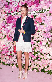 Charlotte Ronson paired her white lacy dress with this preppy blazer at the Slavatore Ferragamo Signorina fragrance launch in NYC.