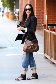 Tia Mowry looked stylish while running errands in a pair of black leather ankle cuff sandals.
