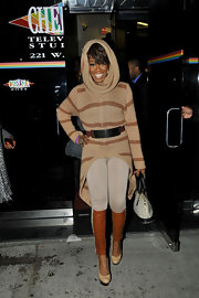 A high-low hem and a hood put a dramatic spin on Tichina Arnold's striped brown knit top.