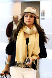 Tiffani Thiessen adorned her black blouse with a fringed beige scarf while catching a flight out of New York.