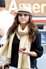Tiffani Thiessen looked summery in a straw hat while catching a flight out of New York.