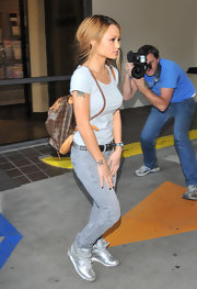 Tila sported a silver metallic pair of kicks with her grey skinny jeans.