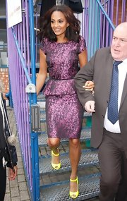 Alesha Dixon contrasted her purple dress with a pair of neon-yellow peep-toe pumps at the Prince's Trust Against All Odds Youth Forum.