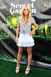 Tinsley accessorized her summer-ready look with white platform wedges.