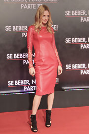Heather Graham looked edgy and chic in this red leather dress that featured lace sleeves.