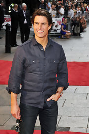 Tom Cruise paired his classic jeans with a denim button down shirt.