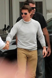 Tom Cruise sported a basic gray sweatshirt while out in Rio greeting fans.