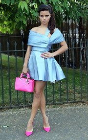 Bip Ling sported a sky blue mini dress that featured wrapped shoulders and a full skirt.