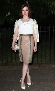 Holliday Grainger kept her top simple and chic with this sleeveless white blouse.