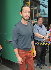 Shia LaBeouf paired a gray crewneck sweater with rust-colored jeans when he appeared on 'Good Morning America.'