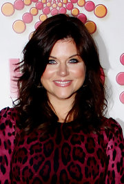 Tiffani Thiessen styled her hair in high-volume layers for the 2011 HBO Emmy Awards after-party.