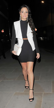 Tulisa chose a black and white fitted jacket while out late in London.