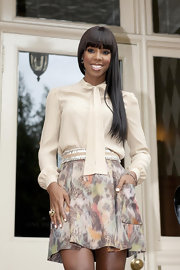 Kelly Rowland styled her hair in a straight cut with blunt cut bangs which framed her oval face.