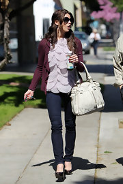 Ashley's oversized white leather satchel complemented her feminine violet petal top. This is a fabulous Spring bag.