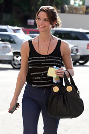 """Twilight"" starlet Ashley Greene, is seen in a stylish zipper tank, high waisted jeans and a leather ""Hysteria"" handbag which she has been seen sporting around LA."