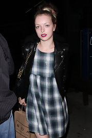 Francesca Eastwood blended casual with edgy when she paired this plaid dress with a black leather jacket.