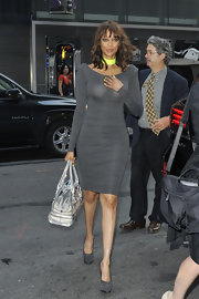 Tyra let her neon necklace and nails shine by wearing them with this dark gray bodycon dress.