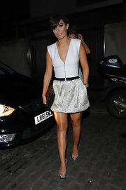 Frankie Sandford chose this white and silver, front-zip frock for her sleek evening look.